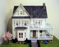 A beautifully finished Victoria's Farmhouse Dollhouse kit manufactured by Real Good Toys.  Excellent job and color scheme!