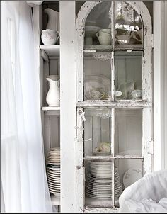 The china closet is a study of woodworking improvisation: Ms. Foster built the shelves, then added arched French doors that she found at a yard sale for $15 each. She has been collecting Limoges china for years.