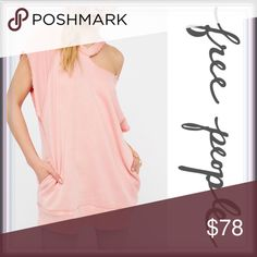 NWT Free People Blush Tunic with pockets ➖NWT ➖BRAND: Free People ➖SIZE: Medium  ➖STYLE: A tunic With Side pockets as well as an asymmetrical cut out that gives it an off the shoulder and Choker top look.    ❌NO TRADES Free People Tops Tunics