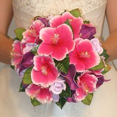 The bouquet of hibiscus flowers are the bridesmaids flowers.