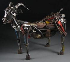 "Sculptor Jud Turner writes, ""I thought you might enjoy this full-sized goat, 'Tanngrisnir', named after one of the two goats in Norse mythology that pulled Thor's chariot. He ate them for dinner every night, saved the bones, and by morning they had come back to life. By Cory Doctorow"