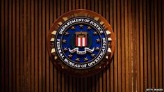 Logo for the US Department of Justice and the FBI