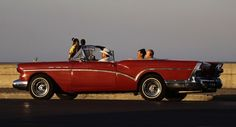 Tourists take a ride in a convertible along the Malecon in Havana. Classic American cars from the Eisenhower era still dot the streets of the capital.