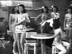 SHIP AHOY, 1942, MGM. A forgotten musical, possibly partly due to the groaner lyrics sung here by Burt Lahr (yes, The Cowardly Lion man) and Red Skelton, but the interest here is ELEANOR POWELL's dancing and her interaction with Buddy Rich the drummer. They nail the drumstick thing at the end.
