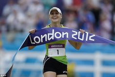 Golden girl: Laura Asadauskaite, of Lithuania, crosses the finish line to win the women's modern pentathlon.