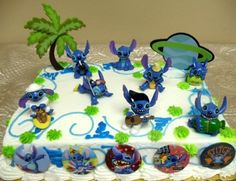 "Unique Lilo and Stitch 16 Piece Birthday Cake Topper Set Featuring 8 Stitch Figures, Palm Tree Decorative Piece, Stitch's Rocket Decorative Cake Piece and 6 1"" Stitch Decorative Cake Buttons by Lilo and Stitch, http://www.amazon.com/gp/product/B005MI3RAA/ref=cm_sw_r_pi_alp_MGy.pb02W2D2S"