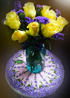 Purple and yellow flower arrangement on vintage hanky