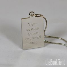 your favorite quote engraved charm necklace. $18.95, via Etsy.