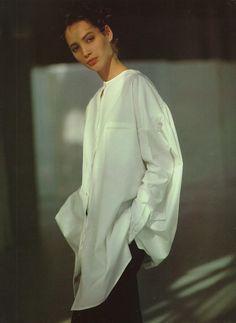 Christy Turlington wearing a simple, asymmetrical button up. Photo by Arthur Elgort.
