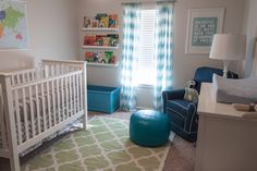 I spy a rug and ottoman pouf from @The Land of Nod! Love the various blues and greens in this #babyboy #nursery