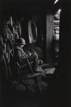 """Vietnam -- photo by David Douglas Duncan.  """"...the sandbag-reinforced doorway...gave good light .. to catch up on those paperback comics from home..."""" -- War Without Heroes, p. 106."""