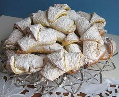 nutty serbian cookies coated in confectioner's sugar remind of me of my grandmother, the one-woman christmas cookie factory.