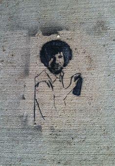 Bob Ross street art. Saw under the bridge in bear creek park in Rochester, Mn. Also saw near Damon Ct.