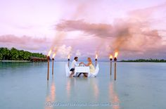 Enjoy a romantic dinner right in the water on the beach at the Aitutaki Resort and Spa in the Cook Islands