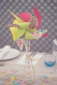 wedding centerpiece with paper pinwheels and confetti @myweddingdotcom