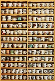 COFFEE MUGS. Love my coffee, love my mugs. I have a cabinet chock full and still keep bringing more into the house. My collection has inspired my stepson to start his own collection of weird mugs. Coffee Shop, Coffee Cups, Tea Cups, Coffee Mug Display, Displaying Collections, Ceramic Mugs, Porcelain Ceramic, Ceramic Pottery, Tea Time