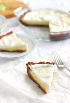 A light, creamy, sweet and perfectly tart Paleo Key Lime Pie with a Coconut Pecan Crust and coconut whipped cream. Gluten free, grain free, dairy free.