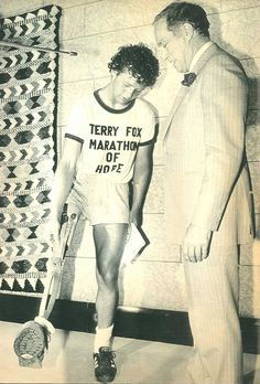 Terry Fox demonstrates for Prime Minister Trudeau how his artificial limb works during a brief meeting on Parliament Hill in Ottawa.