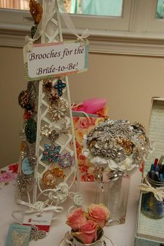 Vintage Tea Party Bridal Shower - Wedding Inspiration- Display of guests brooch gifts, contributions to the Brides Wedding Day ensemble. Alongside is the jewelled Wedding Bouquet they will be added to. More pics of this wedding.