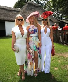 WTF - no wonder the rest of the world laughs at Brits - just look at these 3, who would want to wear a dress plunging that low, to reveal a ghastly tattoo.  The centre woman with her very odd dress/shorts outfit - just horrible but the worst by far is the woman on the left with her camel to trousers and vile top with her breasts going in the opposite directions - get a bra on woman!