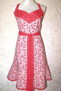 This fun and elegant apron blends a bright cherry blossom print on pink with a whimsical red, pink and white dot pattern. Cooks from Plus to Petite size will benefit from this feminine shaped style with generous width and wrap around shape.  Women's Apron • Retro Apron • Pink Kitchen Apron • Bib Apron • 2 Pocket Apron • Feminine Shape Apron • Red & Pink Apron • FREE SHIPPING