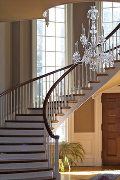Beautiful spiral staircase and chandelier in the Georgian Mansion at Bellewood. Pennsylvania Brides, can you imagine meeting your future husband at the bottom of these steps? Spiral Staircase, Staircase Design, Swan House Atlanta, Georgian Mansion, House Stairs, Wedding Vendors, Future Husband, Pennsylvania, Wedding Decor