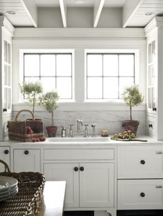 Great vintage kitchen - love the herb topiaries.