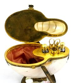 Extremely Rare Nautilus Palais Royal 19th Century Sewing Set. Palais Royal Label: E.Bournat, Galerie de Valois, 112 Palais Royal. Includes 2 scent bottles and 5 sewing items. (open)