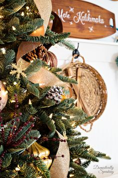 This year's tree is a Rustic Luxe Christmas Tree theme with gold, bronze, white plus lots of pinecones.
