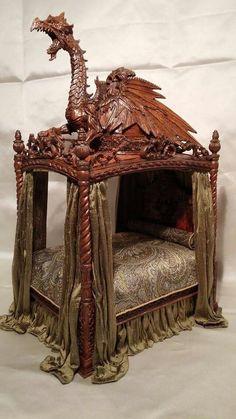 Dragon bed, made by IGMA fellow Michael Reynolds. (jt-another view of this amazing 1/12 dragon bed - now beautifully dressed)