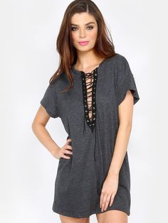 """Casual with a touch of edgy, the Lace Up Short Sleeve T-Shirt dress features a round neck with a lace up plunge center, short sleeves and a relaxed fit. Dress measures 28"""" from shoulder to bottom hem. Pair with slip on sneakers for a retro 90s feel! Modeled in a size S. #summer16 #grunge #90s #laceup #dresses #MakeMeChic #MMC #style #fashion #newarrivals"""