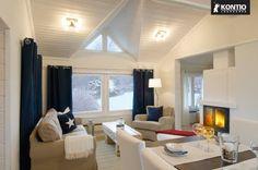 Séjour entièrement blanc dans la maison bois Kontio.