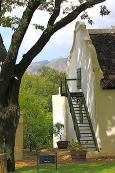 Cape Dutch gable end love this farm house setting - external staircase remember my Grandparents home Life In Paradise, External Staircase, Vernacular Architecture, Vintage Architecture, Cape Dutch, African House, Dutch House, Le Cap, Dutch Colonial