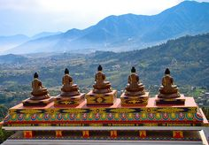 by Tilak Thapa on Flickr.  Five Buddhas on the top of Amitabh Monastery in Nepal.