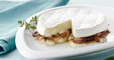 Earthy mushrooms, sweet onions and creamy Brie are baked and served with a baguette for an appetizer that is as savory as the main course.