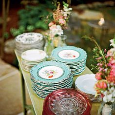 Instead of renting expensive china sets, scour thrift shops, flea markets, and antiques stores to collect mixed china patterns to serve all guests