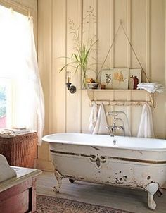 Great tub. and shelf with the towels hanging from it.
