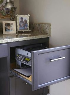 Hide Office Equipment in Drawer. Creatively organized home office boosts your mood and make you more productive.
