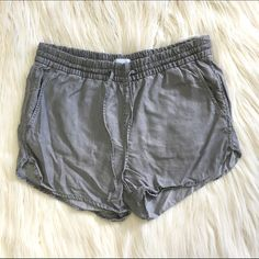 "Gray GAP Shorts These cute shorts have a distress look but are made from a super soft material. Only worn a few times so they're in good condition. 15"" across top, 12"" from top to bottom in front. 100% lyocell GAP Shorts"