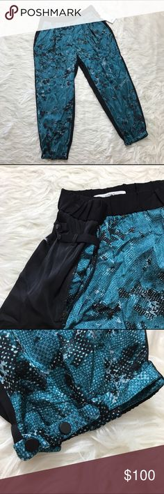NEW! ROBERT RODRIGUEZ 100% silk pants sz 8 teal New! Msrp $325!!! Beautiful lightweight silk pants with beautiful accents around the ankle and hips. Zippered pockets. May fit at ankle length. Teal pattern in front and solid black on the back. Robert Rodriguez Pants Ankle & Cropped