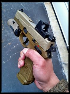 FNH-USA FNP-45 Tactical   Henry loves his FNH firearms, he'd buy the whole catalog if he could