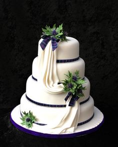 Scottish wedding cake idea, thistle and draping with tartan ribbon around layers