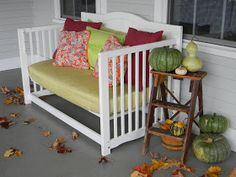 2 little hooligans: Baby crib turned front porch daybed.