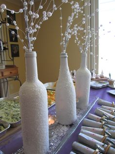 Wine bottles for a center piece for my best friend's wedding shower. It was so easy! i took 2 wine bottles and 1 champagne bottle! Everyone loved it!!