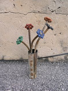 idea: metal flowers in the flower beds