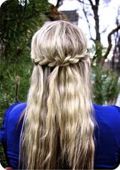 A good half-up, half-down, very simple 'do. I imagine it would be easy to tuck a veil into that big braid.