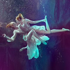 Underwater love:  In an aquatic dream, they lure mere mortals into the deep.  - Photography by Zena Holloway. Celebrating the birth of the goddess of love, they linger and play beneath moonlit waves.  Fashion editorial for B.Inspired Magazine.