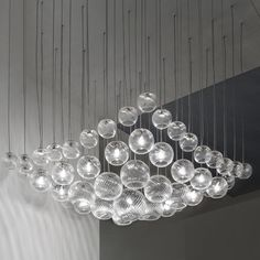The Oto SP Surface Chandelier is made of blown glass spheres in four different sizes hung at different heights on a square canopy. http://www.ylighting.com/vistosi-oto-sp-surface-chandelier.html