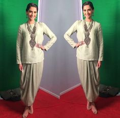 Sonam Kapoor wearing silver grey top with dhoti skirt and a neckpiece by Anamika Khanna for her movie Neerja Promtions