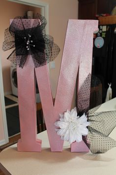 Paper Mache letter spray painted pink 1st then with a silver glitter spray. Decorate with whatever you want...plan to use this on the candy table and then Maddie wants to take it to her dorm room for decoration
